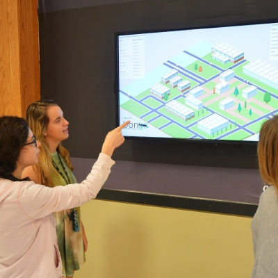 Students view digital signage on campus.