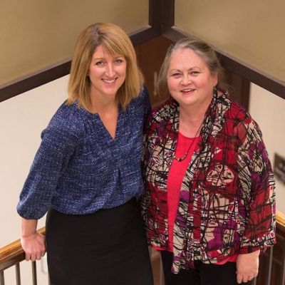 Carmen Nugent (left) and Cindy Roberts (right) worked together to implement the Iowa Scholarship Portal tool.